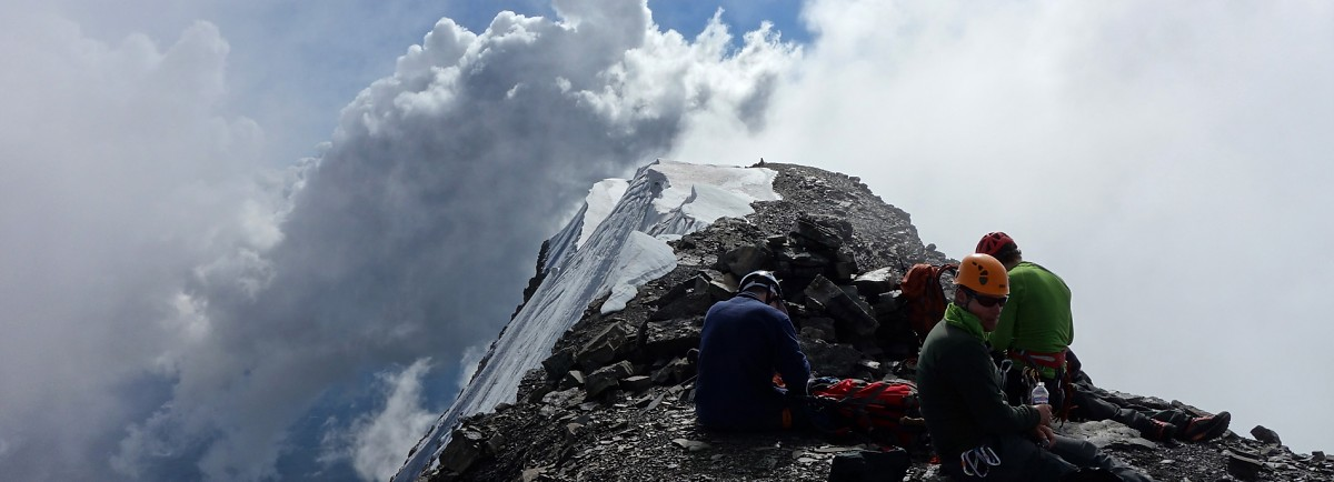 Taking a much deserved break at the third (lowest) summit of Mt. Edith Cavell