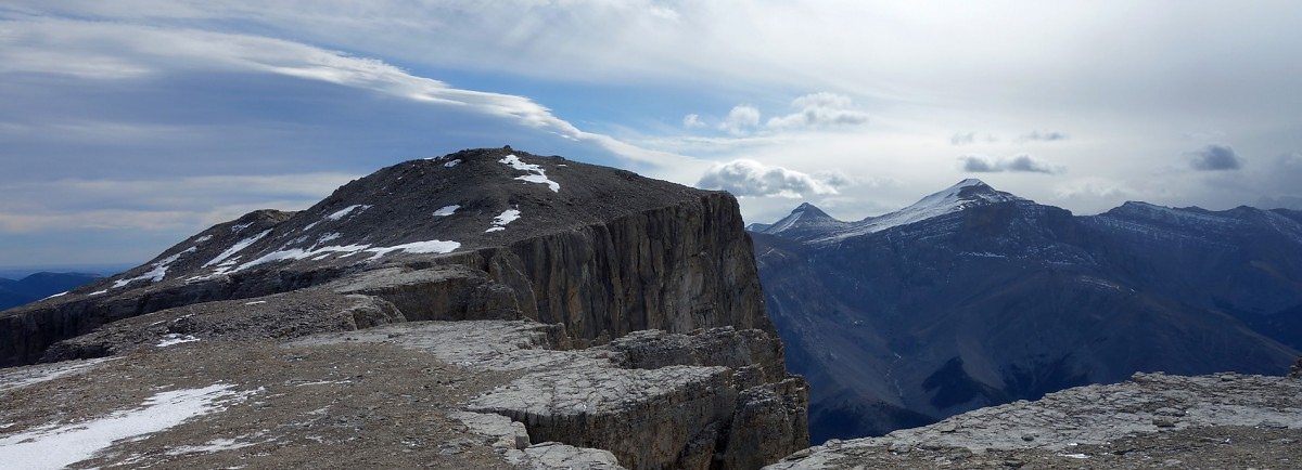 The summit of Mt. Remus, Banded Peak and Mt. Cornwall from the northwest ridge of Mt. Remus