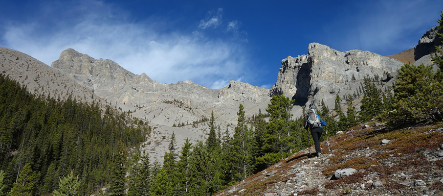 Aga approaches the beautiful mid-mountain area of Mt. Remus with our ascent gully dead-centre.