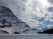 Looking across a frozen Berg Lake at the spectacular Mt. Robson